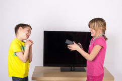 Begging for the remote control Royalty Free Stock Photo