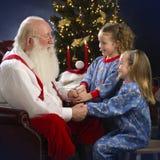 Begging Santa for toys stock photo