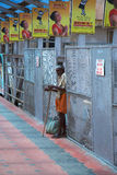 Begging at the Trivandrum train station, India. Royalty Free Stock Images