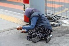 Begging woman in Geneva stock photo