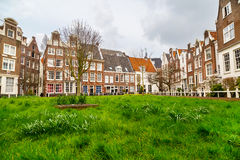 Begijnhof courtyard with historic houses in Amsterdam, Netherlands Royalty Free Stock Photo