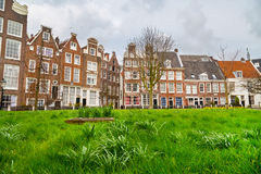Begijnhof courtyard with historic houses in Amsterdam, Netherlands Royalty Free Stock Image