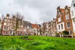Begijnhof courtyard with historic houses in Amsterdam, Netherlands Royalty Free Stock Photography