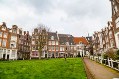 Begijnhof courtyard with historic houses in Amsterdam, Netherlands Stock Photo