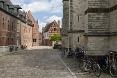Begijnhof, Leuven. Bicycles parked next to the walls of old houses in Grand Beguinage of Leuven royalty free stock photo