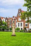 Begijnhof Quarter in Amsterdam. Amsterdam, Netherlands - July 14, 2017: Section of the Begijnhof, an enclosed courtyard dating from the 14th century and a Stock Photos