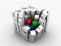 Begin of chaos. Big cube made of small monochrome cubes and three color RGB cubes in process of destruction on white background Royalty Free Stock Photo