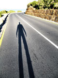 Begin the journey. Portrait photo of the shadow of a person contemplating a journey stock photo