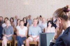 Begin a presentation. Public speaker does not know how to begin a presentation royalty free stock photo
