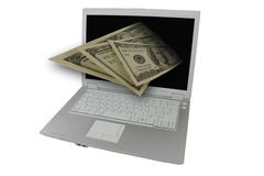 Begin to work on a computer. Money and computer on a white background Royalty Free Stock Images