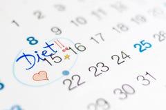 Begin van het dieet in een kalender Stock Foto