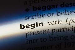 Begin. Word in a dictionary.  concept royalty free stock photo