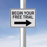 Begin Your Free Trial. A conceptual road sign indicating Begin Your Free Trial stock photo