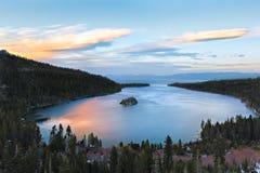 The Begining, Lake Tahoe, Ca. Sunset colors reflect in Emeral Bay at Lake Tahoe, California Royalty Free Stock Photo