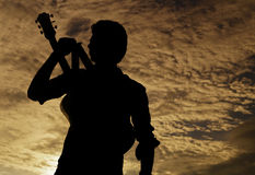 The Begining of the Musical Journey. Silhouette of a guy indicating that he is coming to conquer the world by his music Royalty Free Stock Images
