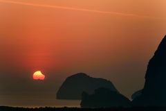 Begining of Solar eclipse sunrise over Phangnga bay Royalty Free Stock Images