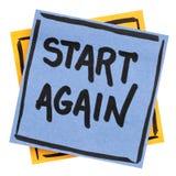 Beginnen Sie wieder Motivanzeige Stockbild