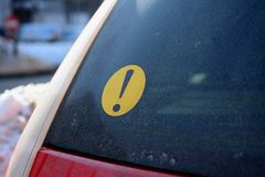 Beginner Driver Sign. Black exclamation mark on a yellow circle representing a beginner driver sign Stock Photography