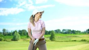 Free Beginner Female Golf Player Holding Club And Smiling, Rejoicing Shot, Victory Stock Photos - 161865413