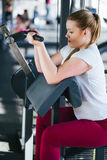 Beginner girl exercising in fitness gym with dumbbells. Beginner girl exercising in fitness gym Royalty Free Stock Photo