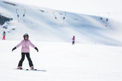 Beginner little girl learning to ski Royalty Free Stock Images