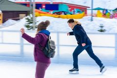 A beginner man rides a skating rink in an open-air ski resort royalty free stock image