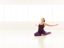 Beginner yoga practice. Young girl , demonstrating yoga pose, full front view Stock Photography