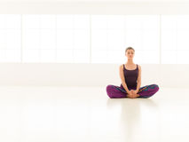 Beginner yoga practice. Young girl , demonstrating yoga pose, full front view Royalty Free Stock Images