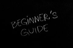 Beginners Guide. Handwritten chalk text Beginner's Guide on the blackboard Royalty Free Stock Photos