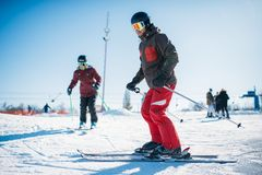 Beginners learn to ski, winter active sport. Beginners learn to ski, skiers in equipment, winter active sport. Skiing from mountains, extreme lifestyle Stock Photos