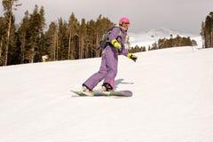 Beginners snowboarder meisje Stock Afbeelding