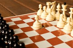 The beginning of the chess game. The concept of the game of chess royalty free stock photo