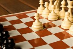 The beginning of the chess game. The concept of the game of chess royalty free stock image
