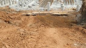 Installing piles, work in laying the foundation building on construction site.