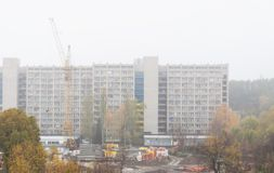 Beginning of construction next to a long-built building Royalty Free Stock Images