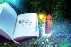 The beginning of the fairy tale. An open book that begins the journey of imagination and door to the magical world. In the moonlight, fairy tales begin Stock Photography