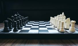 Beginning of the game, Two chess teams in front of different col stock photography