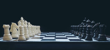 Beginning of the game, Two chess teams in front of different col. Or white and black on the chessboard Stock Photography