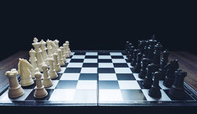 Beginning of the game, Two chess teams in front of different col. Or white and black on the chessboard Royalty Free Stock Image