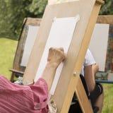 Senior woman sketches in an art studio for the elderly stock photos