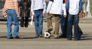 The beginning of a match. Children on the city area play football Royalty Free Stock Photos