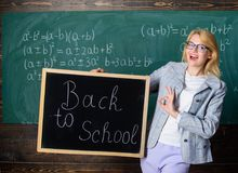 Beginning of new school season. Woman teacher holds blackboard inscription back to school. Are you ready to study. Lady. Educator in classroom wonders you ready royalty free stock photography