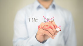 The Beginning, not End, Man Writing on Transparent Screen. High quality stock photography