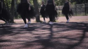 Beginning of the performance of young girls. Dance of beautiful girls in suits on a summer warm day stock video footage