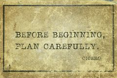Plan before Cicero. Before beginning, plan carefully - ancient Roman philosopher Cicero quote printed on grunge vintage cardboard Stock Photography