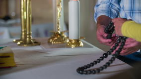 Beginning with the rosary prayer stock footage
