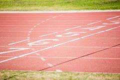 The beginning of the running track Stock Photo