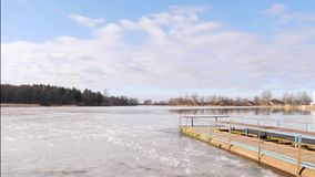 The beginning of spring. jetty on the lake in the ice. The beginning of spring. jetty on the lake in the ice stock footage