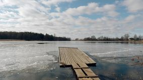 The beginning of spring. jetty on the lake in the ice. The beginning of spring. jetty on the lake in the ice stock video