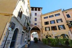 The beginning of the stone bridge Ponte Pietra (Pons Marmoreus) in Verona, Italy Royalty Free Stock Image